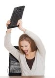 Angry woman throwing a pc keyboard Stock Photography