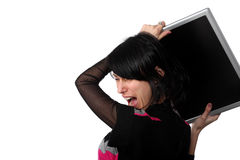 Angry woman about to throw his computer stock photo