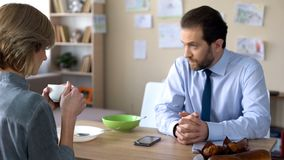 Angry woman trying to talk with busy husband, misunderstanding in family royalty free stock photo