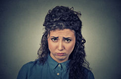 Angry woman, upset about to have nervous breakdown. Closeup portrait of angry young woman, upset about to have nervous breakdown isolated on gray wall background Stock Images