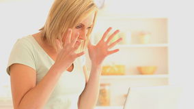 Angry woman using her laptop stock footage
