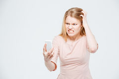 Angry woman using smartphone Royalty Free Stock Image