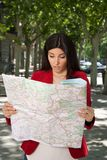 Angry woman watching a map Royalty Free Stock Photos