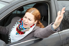 Angry woman waving hers hand and screaming Stock Photo