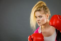 Angry woman wearing boxing gloves Royalty Free Stock Photo