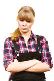 Angry woman wearing dungarees and check shirt Royalty Free Stock Photography