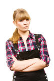 Angry woman wearing dungarees and check shirt Royalty Free Stock Images