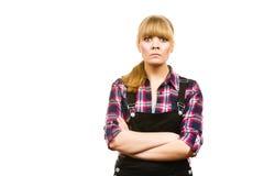 Angry woman wearing dungarees and check shirt Royalty Free Stock Photos