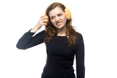 Angry woman with winter headphones Royalty Free Stock Image