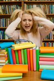 Angry woman yelling, Caucasian girl with long hair, screaming with fury in the library royalty free stock photos