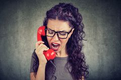 Free Angry Woman Yelling On The Phone Stock Photos - 116463413