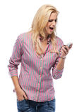 Angry woman yelling into phone Royalty Free Stock Photography