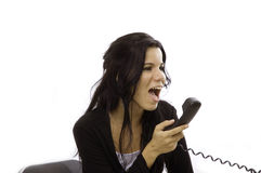 Angry woman yelling in phone. Angry receptionist yelling in the phone - isolated over white background Royalty Free Stock Photos