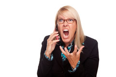 Angry Woman Yells While On Cell Phone. Isolated on a White Background Royalty Free Stock Photo