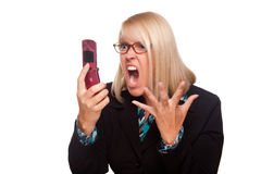 Angry Woman Yells At Cell Phone. Isolated on a White Background Royalty Free Stock Image
