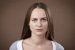 Angry woman. Young adult woman looking at camera displeased and angry royalty free stock photography
