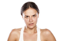 Angry woman. Angry young woman without make-up Stock Photography