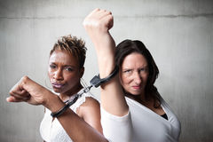 Angry women in handcuffs Stock Photos