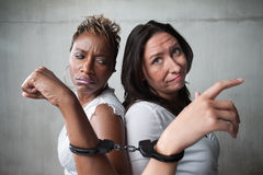Angry women in handcuffs Stock Photography