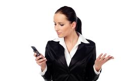 Angry women look at cellphone. Isolated Royalty Free Stock Photo