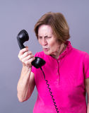 Angry Women with Vintage Telephone Stock Photo