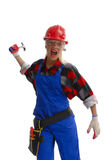 Angry worker. An angry female construction worker raises the hammer in her hand as if to strike something Stock Photo