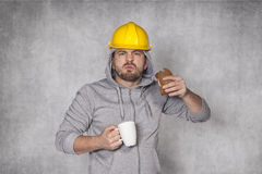 Angry worker ate a sandwich Royalty Free Stock Photos