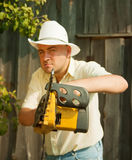 Angry worker with   chainsaw Stock Images