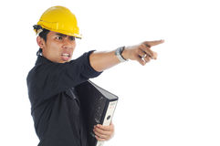 Angry workers pointing to his left. Angry workers wearing safety helmet pointing to his left isolated white background Royalty Free Stock Images