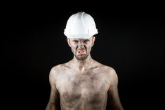 Angry working in a dirty helmet Royalty Free Stock Photos