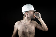 Angry working in a dirty helmet Stock Photo