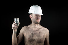 Angry working in a dirty helmet Royalty Free Stock Images