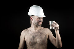 Angry working in a dirty helmet Royalty Free Stock Image
