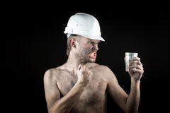 Angry working in a dirty helmet Royalty Free Stock Photography
