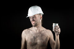 Angry working in a dirty helmet Stock Images