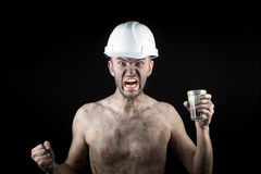 Angry working in a dirty helmet Stock Photography