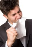 Angry writer. Eating a piece of paper Royalty Free Stock Photography