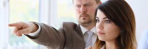 Angry yelling boss point arm to exit dismissing sad worker. With stuff box portrait. Bad news pack and carry belongings hopeless human resources staff reduction Royalty Free Stock Images