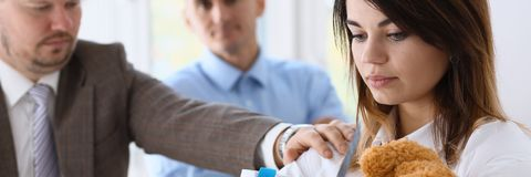 Angry yelling boss point arm to exit dismissing sad worker. With stuff box portrait. Bad news pack and carry belongings hopeless human resources staff reduction Royalty Free Stock Photography