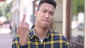Angry young african man showing middle finger, abusive behavior stock footage