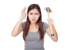 Angry young Asian woman with hammer Royalty Free Stock Photo