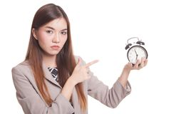 Angry young Asian woman point to a clock. Stock Photography