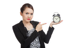 Angry young Asian woman point to a clock Stock Images