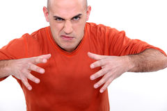 Angry young bald man Stock Image