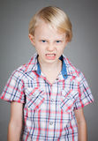 Angry young boy. Stock Photos
