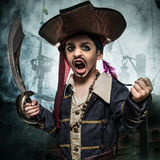 A angry young boy wearing a pirate costume Stock Photo