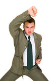 Angry young business man. Angry young man of business who does kung fu Stock Photo