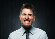 Angry young businessman Stock Photos