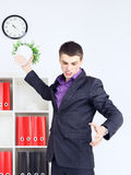 Angry Young Businessman. Angry young confident businessman in his office Royalty Free Stock Image
