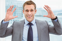 Angry young businessman at office Stock Photography
